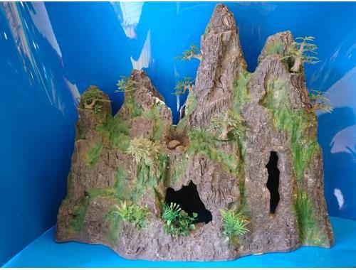 Фото Скала полая с деревцами Смотреть